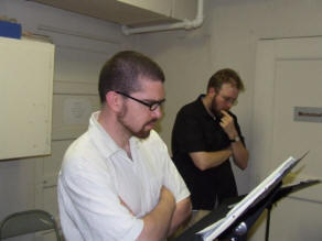 Image of Marc Friedman (Director) and Ben Shergy (Production Assistant) reading along at rehearsal.