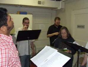 Image of Paul Susi, Marc Friedman, Ben Shergy, and Linda Goertz at rehearsal.