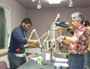 Paul Susi and David Loftus prepare the microphone for recording.